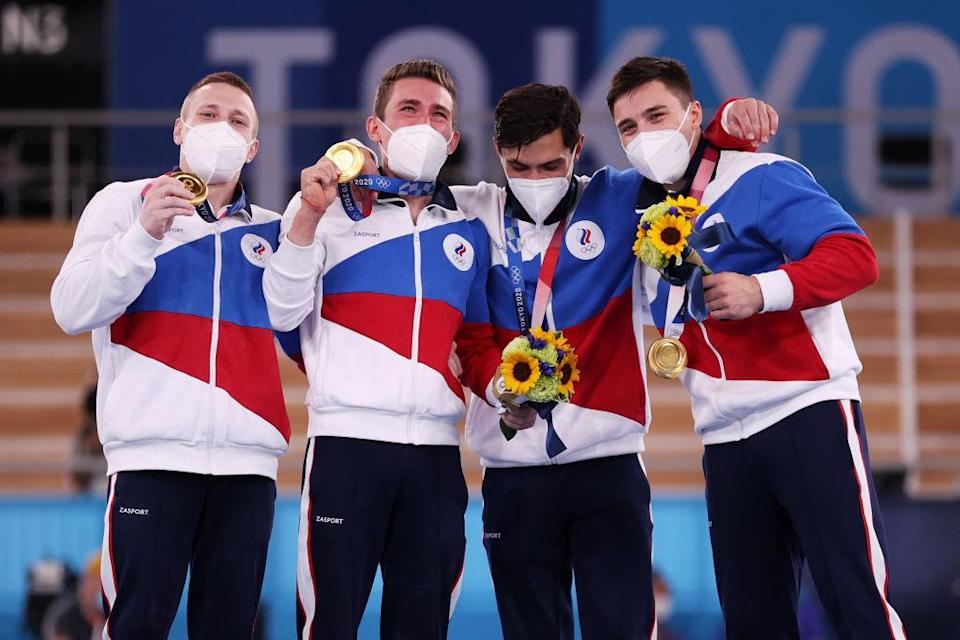 """David Belyavskiy, Nikita Nagornyy, Artur Dalaloyan and Denis Abliazin of Team ROC pose with the gold medal after winning the Men's Team Final on day three of the Tokyo 2020 Olympic Games at Ariake Gymnastics Centre on July 26, 2021 in Tokyo, Japan.<span class=""""copyright"""">Jamie Squire—Getty Images</span>"""