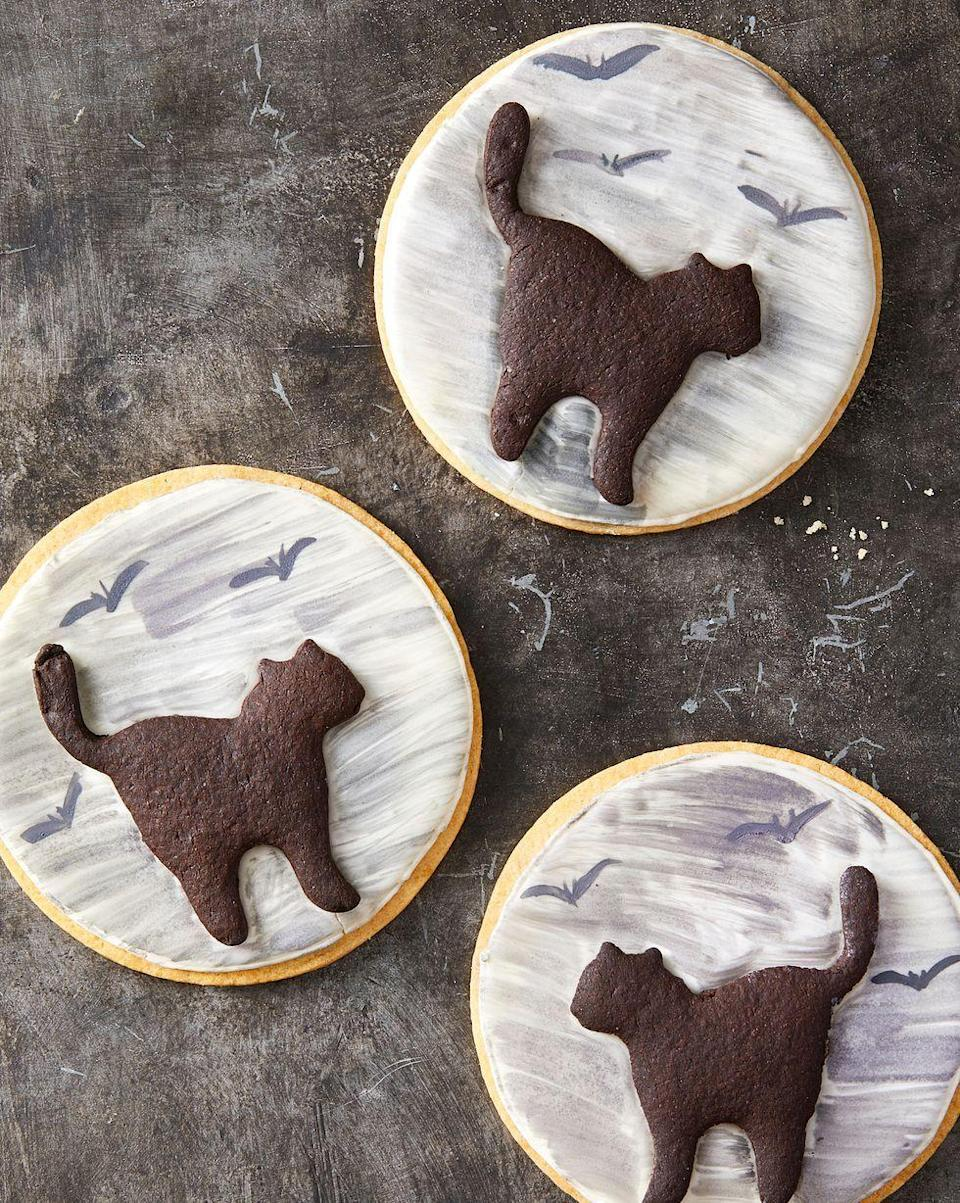 """<p>No bad luck here, only black cats (made from delicious <a href=""""https://www.goodhousekeeping.com/food-recipes/a28566904/black-cocoa-cookies-recipe/"""" rel=""""nofollow noopener"""" target=""""_blank"""" data-ylk=""""slk:Black Cocoa Cookies"""" class=""""link rapid-noclick-resp"""">Black Cocoa Cookies</a>!) crossing in front of a full moon.</p><p><em><a href=""""https://www.goodhousekeeping.com/food-recipes/party-ideas/a28609114/black-cat-cookies-recipe/"""" rel=""""nofollow noopener"""" target=""""_blank"""" data-ylk=""""slk:Get the recipe for Black Cat Cookies »"""" class=""""link rapid-noclick-resp"""">Get the recipe for Black Cat Cookies »</a></em></p>"""