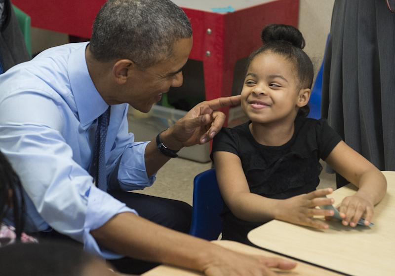 Obama talks with Akira Cooper during a visit to a classroom at the Community Children's Center in Lawrence, Kansas, in January 2015. (Photo: SAUL LOEB via Getty Images)