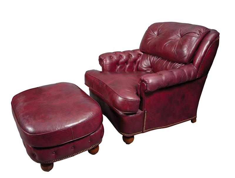This undated photo provided by Doyle New York shows a burgundy leather club chair and ottoman which belonged to former Mayor Ed Koch, and will now be sold at auction. Furniture, decorations and art from Koch's Greenwich Village apartment are being offered Monday, Nov. 18, 2013 by Doyle New York. The three-term mayor's letters and books will go on sale Nov. 25. Koch died in February at the age of 88. (AP Photo/Doyle New York)