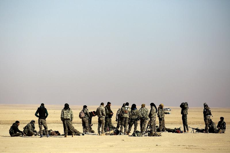 Fighters from the Syrian Democratic Forces gather near a village north-east of Raqa
