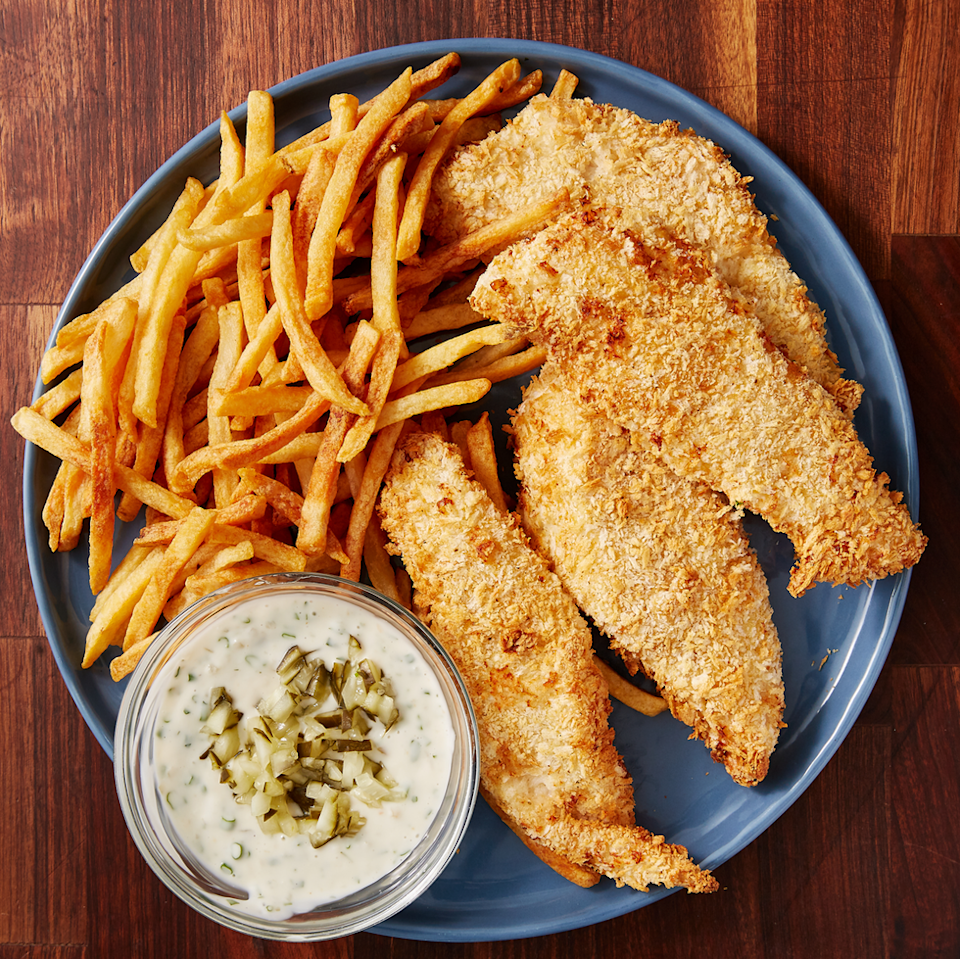 """<p>This air fryer fish is the perfect. It is every bit as crunchy and the fish stays perfectly flaky. Skipping the frying means no unnecessary oil and it takes less time! </p><p>Get the <a href=""""https://www.delish.com/uk/cooking/recipes/a30790141/air-fryer-fish-recipe/"""" rel=""""nofollow noopener"""" target=""""_blank"""" data-ylk=""""slk:Air Fryer Fish"""" class=""""link rapid-noclick-resp"""">Air Fryer Fish</a> recipe.</p>"""