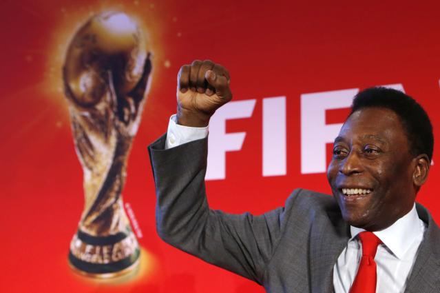 """Brazilian soccer legend Pele reacts as he poses after a news conference to present the FIFA World Cup global """"Trophy Tour"""" in Paris March 10, 2014. The 2014 World Cup will be held in Brazil from June 12 through July 13. REUTERS/Gonzalo Fuentes (FRANCE - Tags: SPORT SOCCER WORLD CUP)"""