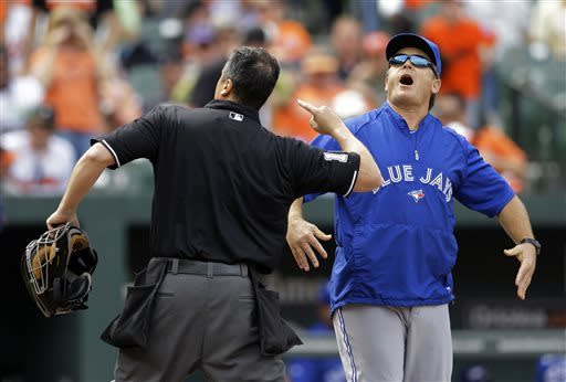 Toronto Blue Jays manager John Gibbons reacts as home plate umpire Mike DiMuro ejects him during an argument over a strikeout call against Toronto's Brett Lawrie in the ninth inning of a baseball game against the Baltimore Orioles on Wednesday, April 24, 2013, in Baltimore. Toronto won 6-5 in 11 innings. (AP Photo/Patrick Semansky)