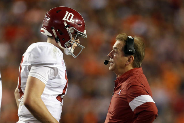 Alabama quarterback Mac Jones (10) talks with head coach Nick Saban during the Iron Bowl against Auburn on Nov. 30. (AP Photo/Butch Dill)