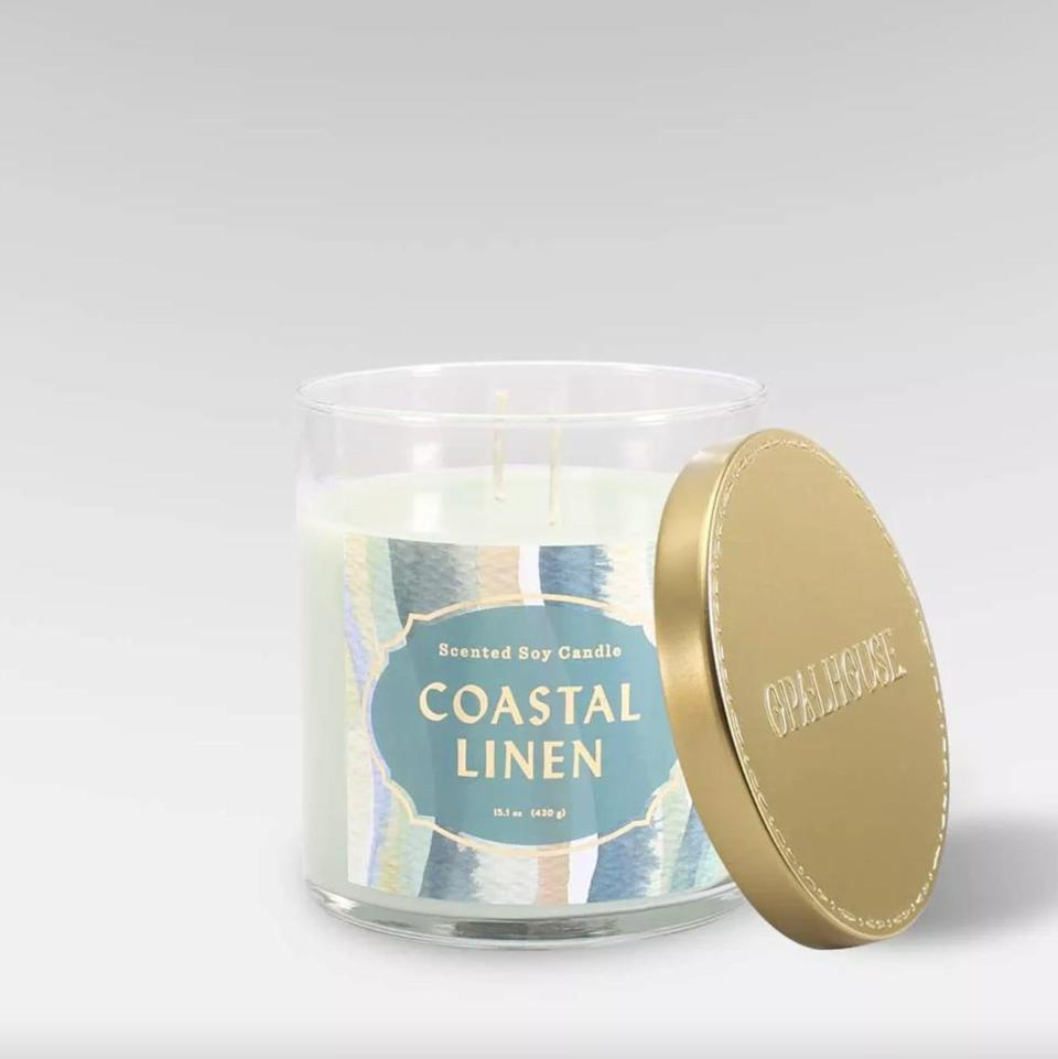 <p>Your home will smell like a seaside escape in mere minutes after you light this <span>Coastal Linen Lidded Glass Jar 2-Wick Candle</span> ($10).</p>