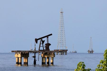 FILE PHOTO: Oil facilities are seen on Lake Maracaibo in Cabimas, Venezuela January 29, 2019. REUTERS/Isaac Urrutia/File Photo