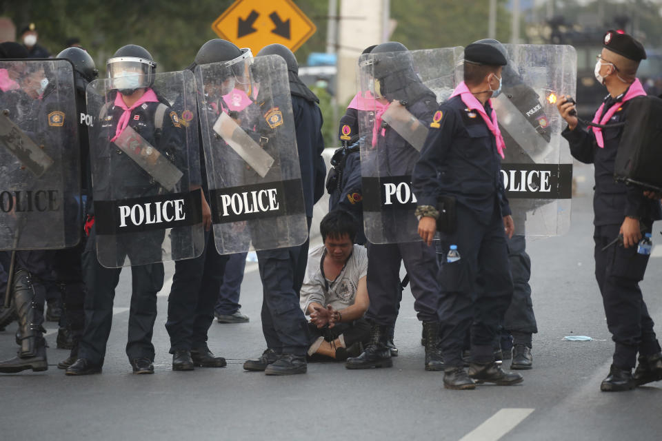 Riot policemen arrest an anti-government protester, during a protest in Bangkok, Thailand, Sunday, Feb. 28 , 2021. (AP Photo)