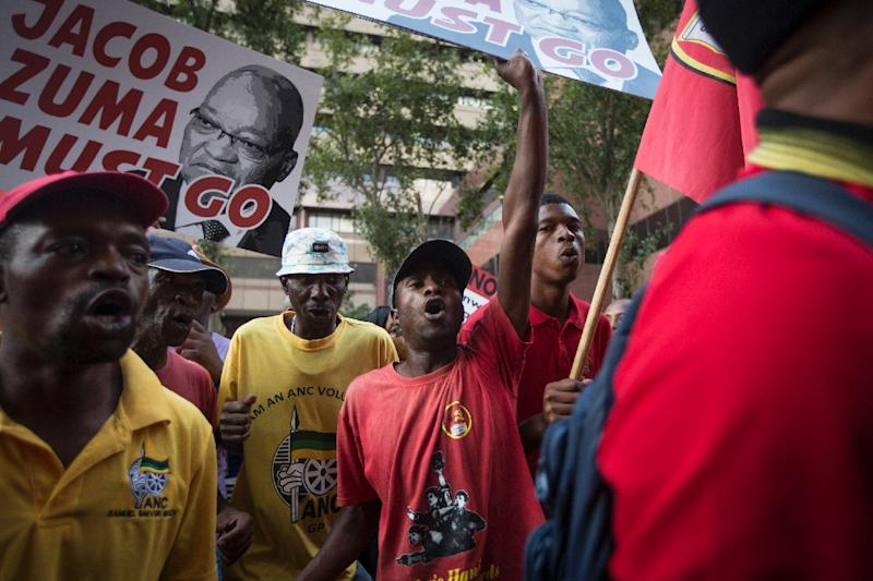 Protesters call for the resignation of South African President Jacob Zuma after a highly controversial cabinet reshuffle
