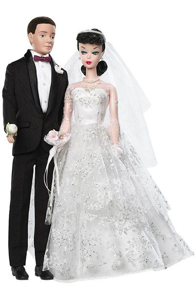"""<div class=""""caption-credit""""> Photo by: Mattel</div><div class=""""caption-title"""">1959: The Original Wedding Day Barbie Doll And Ken Set</div>Re-released in 2009 to celebrate the doll's 50th anniversary, this iconic doll's sweetheart neckline and gloves perfectly reflect <a href=""""http://www.bridalguide.com/planning/wedding-planning-basics/weddings-through-the-ages"""">the era's wedding-day style</a>."""