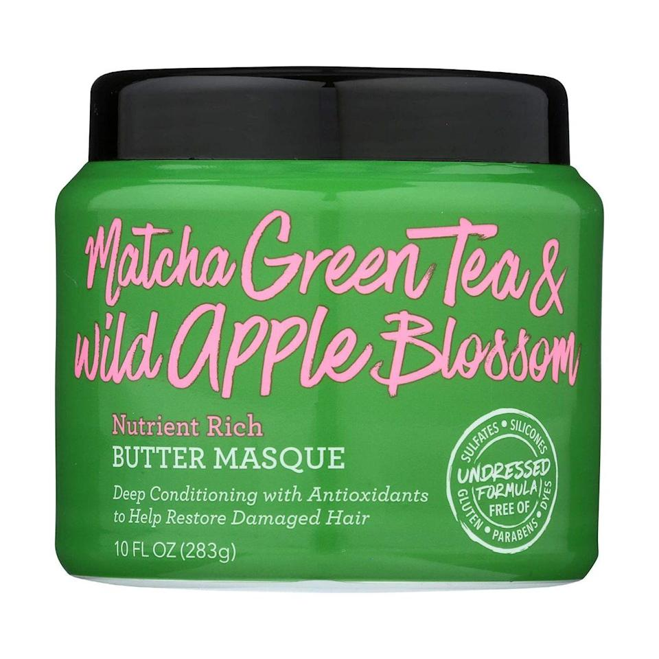 """Not Your Mother's Matcha Green Tea & Wild Apple Blossom Nutrient Rich Butter Masque is an antioxidant-rich hair mask that's especially great for wavy hair, thanks to lightweight ingredients like vitamin E-packed <a href=""""https://www.allure.com/story/matcha-green-tea-skin-care?mbid=synd_yahoo_rss"""" rel=""""nofollow noopener"""" target=""""_blank"""" data-ylk=""""slk:matcha green tea"""" class=""""link rapid-noclick-resp"""">matcha green tea</a>, conditioning <a href=""""https://www.allure.com/story/what-is-glycerin-skin-care-ingredient?mbid=synd_yahoo_rss#:~:text=What%20glycerin%20means%20for%20your,or%20even%20on%20its%20own."""" rel=""""nofollow noopener"""" target=""""_blank"""" data-ylk=""""slk:glycerin"""" class=""""link rapid-noclick-resp"""">glycerin</a>, and moisturizing almond oil. The formula is also free from silicones, phthalates, and parabens. Apply after shampooing once or twice a week for up to five minutes before rinsing out."""