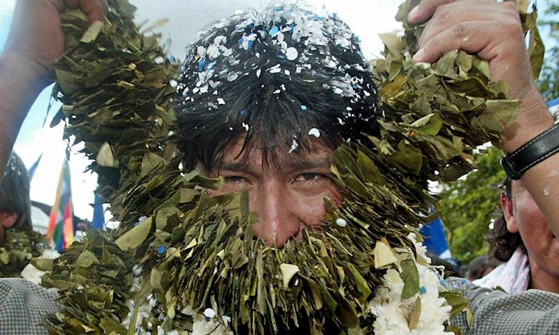 Morales, then president-elect, takes off a garland of coca leaves during a rally in Eterazama, in his home province of Chapare in 2005.
