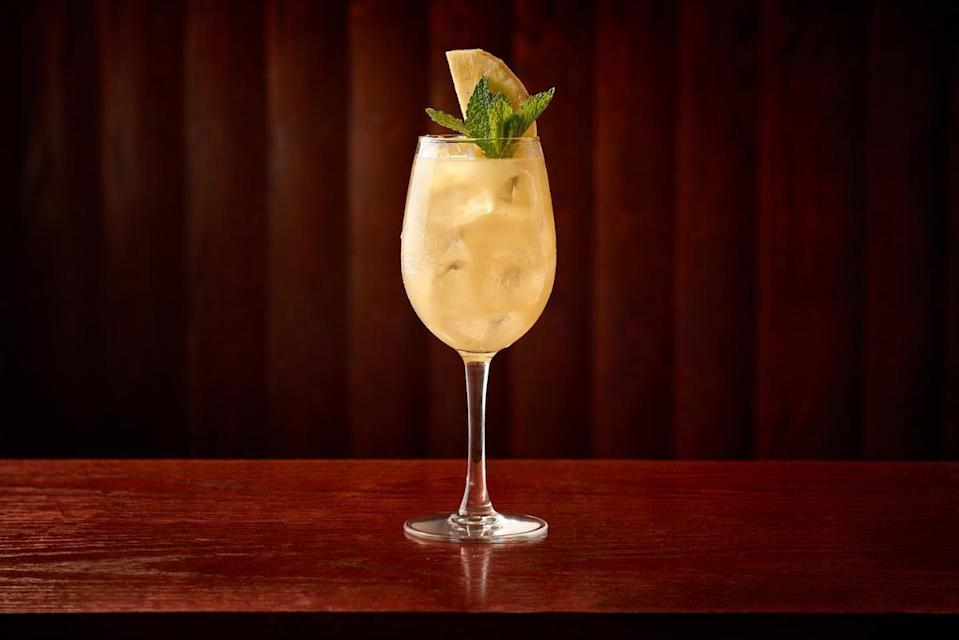 """<p>Make a fresh sour mix <a href=""""https://www.thedailymeal.com/drink/how-to-curate-bar-cart?referrer=yahoo&category=beauty_food&include_utm=1&utm_medium=referral&utm_source=yahoo&utm_campaign=feed"""" rel=""""nofollow noopener"""" target=""""_blank"""" data-ylk=""""slk:for your bar cart"""" class=""""link rapid-noclick-resp"""">for your bar cart</a> and add that and some club soda to a mix of pineapple chunks and mint leaves for a non-alcoholic, tropical twist on the mint julep.</p> <p><a href=""""https://www.thedailymeal.com/recipes/pineapple-mint-julep-mocktail-carmines?referrer=yahoo&category=beauty_food&include_utm=1&utm_medium=referral&utm_source=yahoo&utm_campaign=feed"""" rel=""""nofollow noopener"""" target=""""_blank"""" data-ylk=""""slk:For the Pineapple Mint Julep recipe, click here."""" class=""""link rapid-noclick-resp"""">For the Pineapple Mint Julep recipe, click here.</a></p>"""