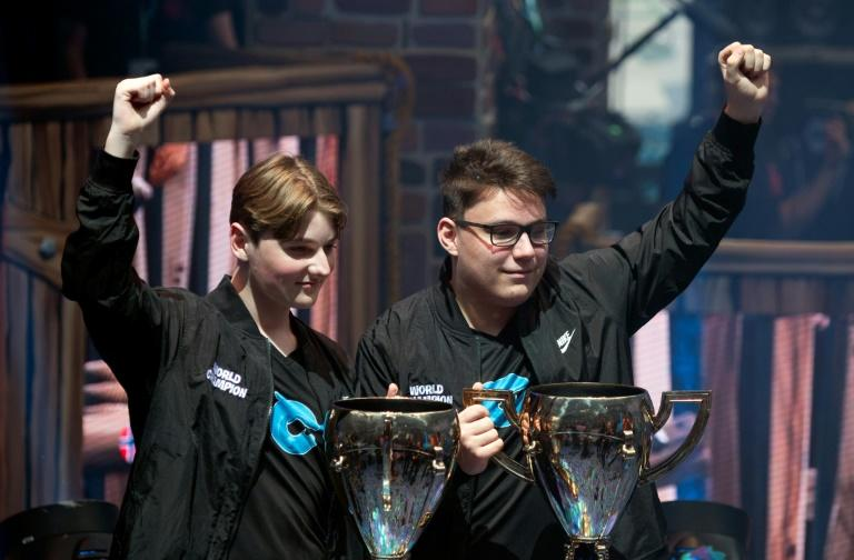 """Gamers """"Nyhrox"""" and """"aqua"""" pose after winning the duos competition during the 2019 Fortnite World Cup Finals on July 27 inside Arthur Ashe Stadium, in New York"""