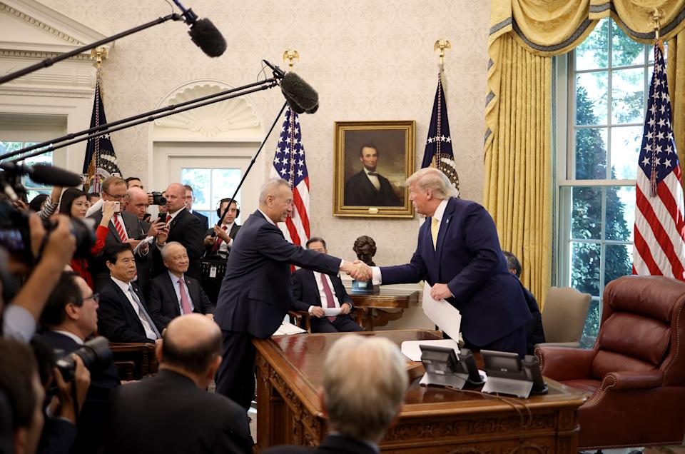 WASHINGTON, DC - OCTOBER 11: U.S. President Donald Trump shakes hands with Chinese Vice Premier Liu He in the Oval Office at the White House October 11, 2019 in Washington, DC. President Trump announced a 'phase one' partial trade deal with China. China and the United States have slapped each other with hundreds of billions of dollars in tariffs since the current trade war began between the world's two largest national economies in 2018. (Photo by Win McNamee/Getty Images)