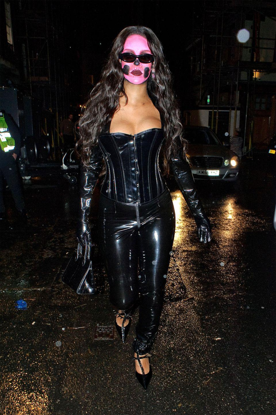 <p>Rihanna dons pink skeleton makeup and black patent leather. </p>