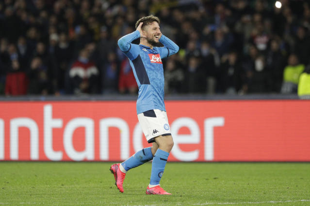 Napoli's Dries Mertens celebrates after scoring during the Champions League, Round of 16, first-leg soccer match between Napoli and Barcelona, at the San Paolo Stadium in Naples, Italy, Tuesday, Feb. 25, 2020. (AP Photo/Andrew Medichini)