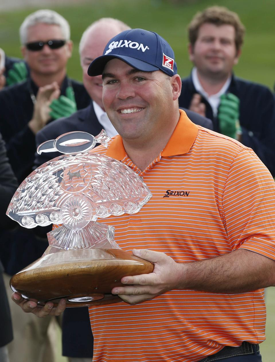 Kevin Stadler smiles as he receives the championship trophy as the tournament winner after the final round of the Phoenix Open golf tournament on Sunday, Feb. 2, 2014, in Scottsdale, Ariz. (AP Photo/Ross D. Franklin)