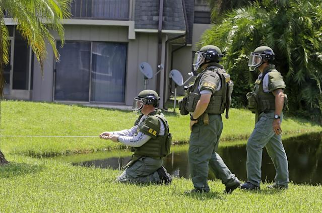 <p>Bomb disposal officers check for bombs at an apartment complex of a suspect linked to the fatal shootings at an Orlando nightclub, Sunday, June 12, 2016, in Fort Pierce, Fla. (AP Photo/Alan Diaz) </p>