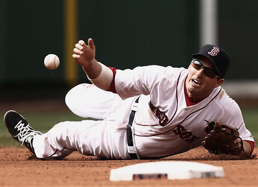 Boston Red Sox shortstop Stephen Drew can't handle a ground ball by Tampa Bay Rays' Desmond Jennings however Dustin Pedroia retrieved the ball and threw out Jennings at first during the sixth inning of a baseball game at Fenway Park in Boston Sunday, April 14, 2013. (AP Photo/Winslow Townson)