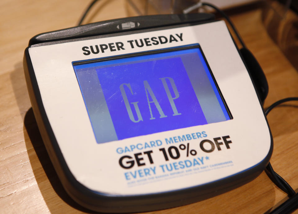 A credit card machine is shown at a Gap store in Palo Alto, Calif., Tuesday, Feb. 23, 2010. (AP Photo/Paul Sakuma)