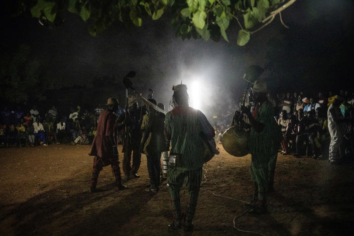 Dozos, ancient hunters who have been drawn into the Islamic extremist fight, participate in a celebration of their culture in Bobo-Dioulasso, Burkina Faso, 360 kilometers (220 miles) west of the capital, Ouagadougou, on Sunday, March 28, 2021. While many Burkinabe grew up familiar with traditional protective practices, some never participated in them until the jihadists arrived several years ago. (AP Photo/Sophie Garcia)