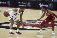 South Carolina guard Seventh Woods (23) is defended by Arkansas guard JD Notae (1) during the first half of an NCAA college basketball game Tuesday, March 2, 2021, in Columbia, S.C. (AP Photo/Sean Rayford)