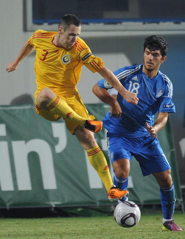 Lucian Murgoci (L) of Romania vies for the ball with Dimitris Kolovos (R) of Greece during the final football match of the UEFA European Under-19 Championship 2010/2011 in Berceni village next to Bucharest July 23, 2011. Greece won 1-0. AFP PHOTO/DANIEL MIHAILESCU (Photo credit should read DANIEL MIHAILESCU/AFP/Getty Images)