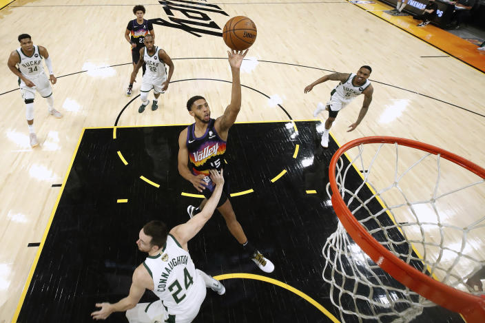 Phoenix Suns' Cameron Payne (15) shoots over Milwaukee Bucks' Pat Connaughton (24) during the first half of Game 1 of basketball's NBA Finals, Tuesday, July 6, 2021, in Phoenix. (Christian Petersen/Pool Photo via AP)