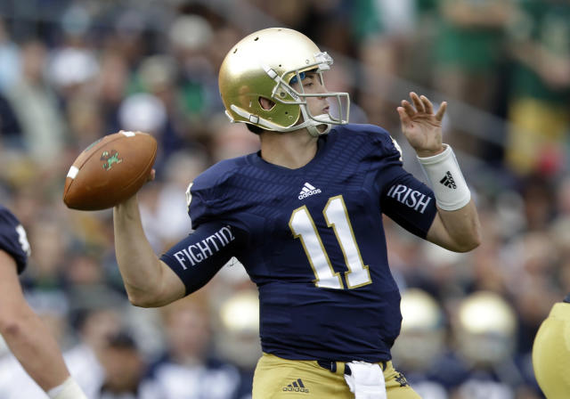 Notre Dame quarterback Tommy Rees throws against Michigan State during the first half of an NCAA college football game in South Bend, Ind., Saturday, Sept. 21, 2013. (AP Photo/Michael Conroy)