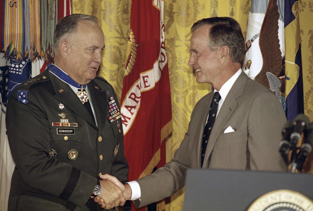 FILE - In this July 4, 1991 file photo, President George Bush congratulates Desert Storm commander Gen. Norman Schwarzkopf after presenting him with the medal of freedom at the White House in Washington. Schwarzkopf died Thursday, Dec. 27, 2012 in Tampa, Fla. He was 78. (AP Photo/Doug Mills, File)