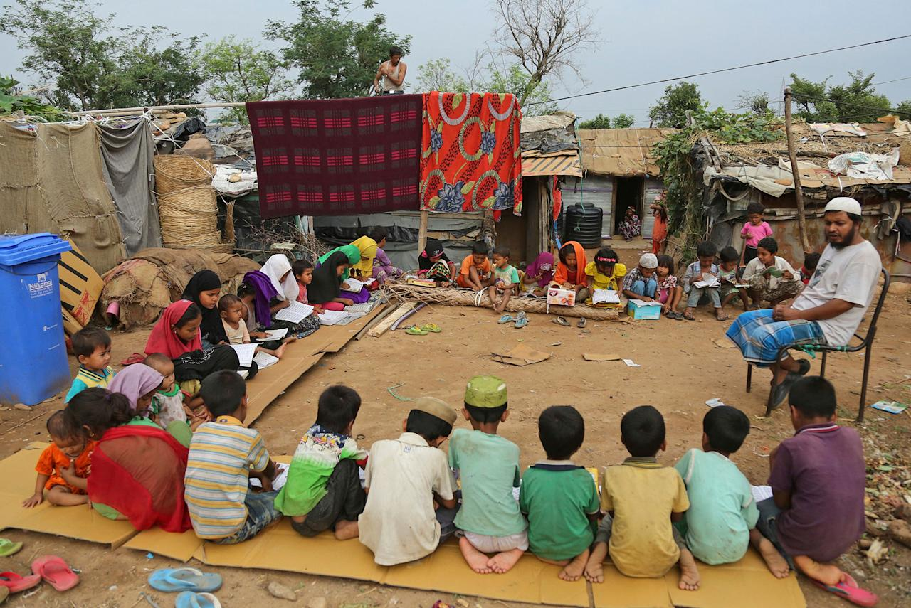 <p>Rohingya refugee children attend a Madrassa, or Islamic religious school in a temporary shelter on the outskirts of Jammu, India, Tuesday, June 20, 2017. Facing persecution in Myanmar, thousands of members of Myanmar's minority Rohingya community have crossed over to India over the past years. Tuesday marks World Refugee Day. (Photo: Channi Anand/AP) </p>