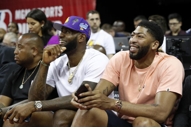 LeBron James and Anthony Davis share a laugh during NBA Summer League on Friday in Las Vegas. (AP Photo/Steve Marcus)