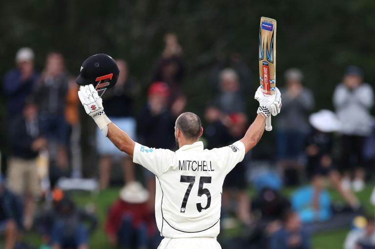 Daryl Mitchell celebrates reaching his maiden Test century as New Zealand declared at a huge 659-6