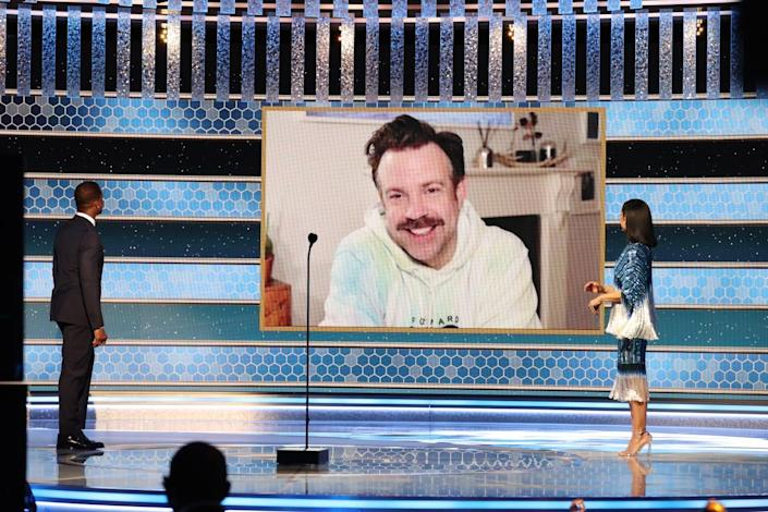 Jason Sudeikis on a video screen