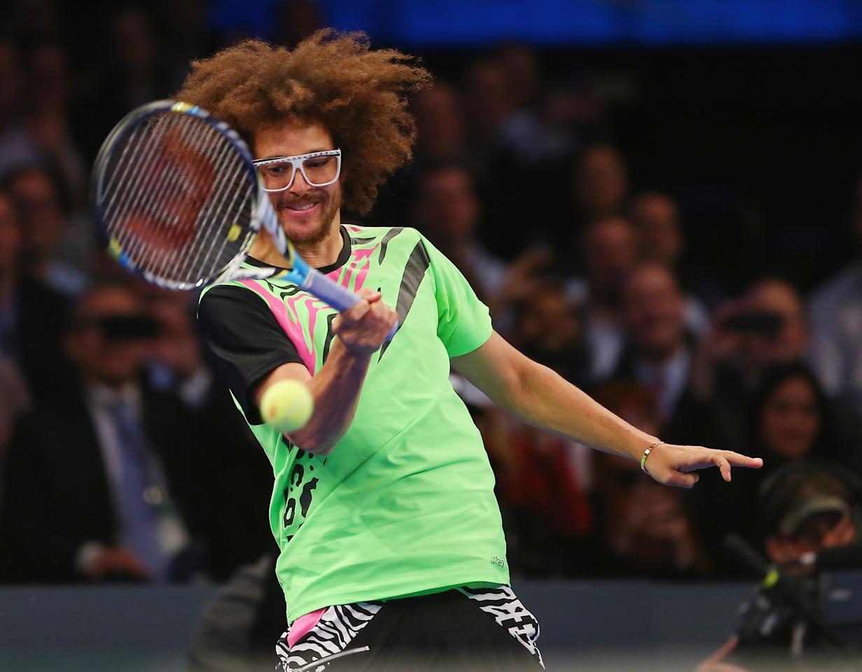 NEW YORK, NY - MARCH 04:  LMFAO singer Redfoo returns a shot to Serena Williams of the USA in her match against Victoria Azarenka of Belarus during the BNP Paribas Showdown on March 4, 2013 at Madison Square Garden in New York City.  (Photo by Elsa/Getty Images)
