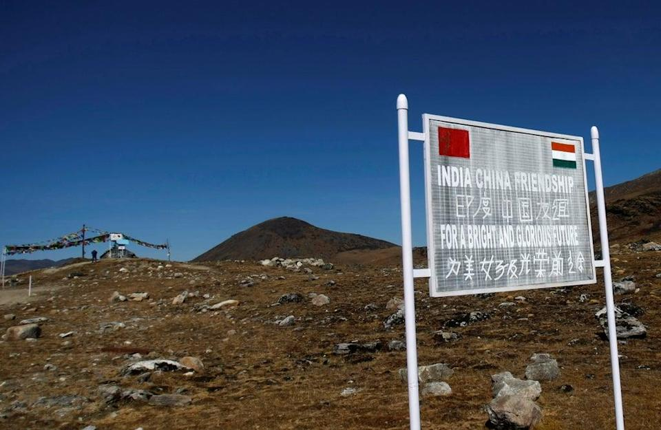A signboard is seen from the Indian side of the Indo-China border at Bumla in Arunachal Pradesh (REUTERS)