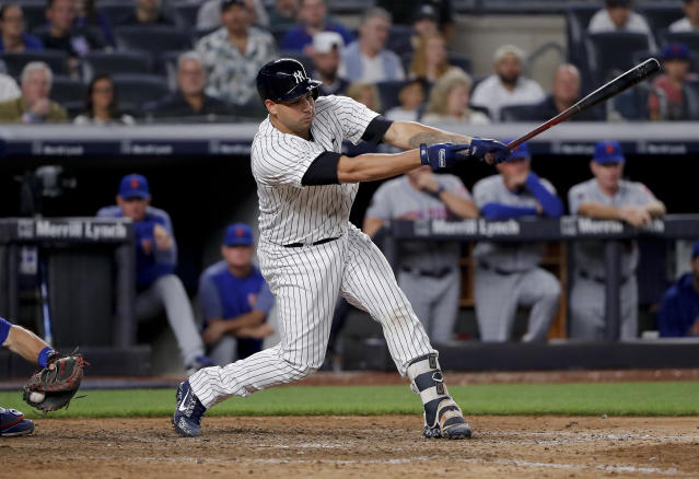 New York Yankees' Gary Sanchez strikes out swinging with two runners on base to end the eighth inning of a baseball game against the New York Mets, Friday, July 20, 2018, in New York. (AP Photo/Julie Jacobson)