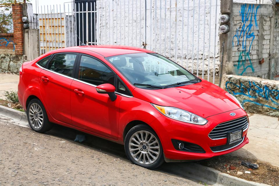 Oaxaca, Mexico - May 25, 2017: Red compact car Ford Fiesta in the city street.