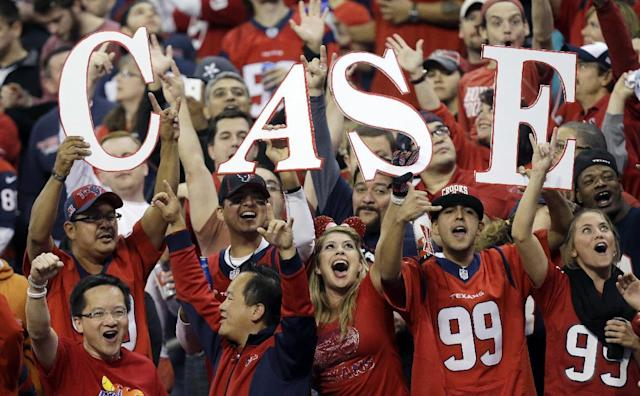 Fans cheer for Houston Texans' Case Keenum during the first quarter of an NFL football game against the Indianapolis Colts, Sunday, Nov. 3, 2013, in Houston. (AP Photo/Patric Schneider)