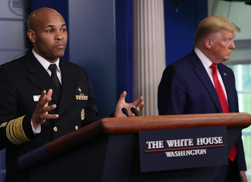 WASHINGTON, DC - APRIL 03: U.S. Surgeon General Jerome Adams speaks while flanked by U.S. President Donald Trump during a White House Coronavirus Task Force briefing at the White House April 3, 2020 in Washington, DC. President Trump announced that Americans in virus hot spots should wear a mask when out in public as the death rate caused by coronavirus has nearly doubled in three days in New York City while the nation continues to reel from the impacts of COVID-19. (Photo by Win McNamee/Getty Images)