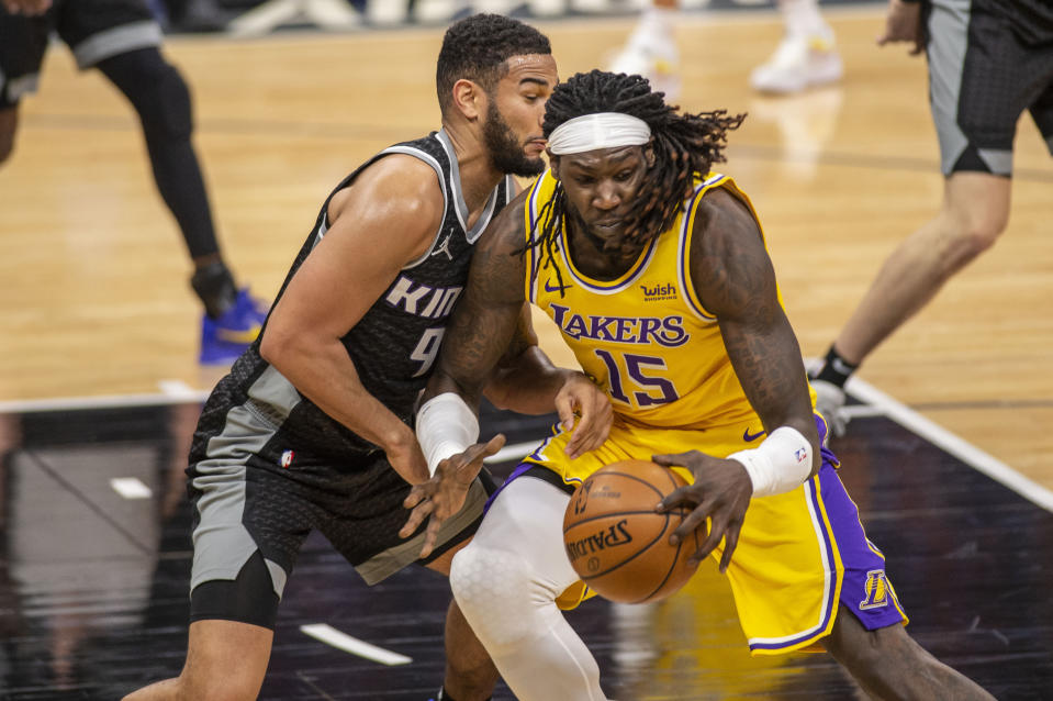 Los Angeles Lakers center Montrezl Harrell (15) drives to the basket as he's defended by Sacramento Kings guard Cory Joseph (9) during the second half of an NBA basketball game in Sacramento, Calif., Wednesday, March 3, 2021. (AP Photo/Hector Amezcua)