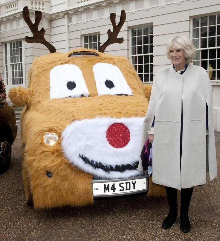 <p>During a Christmas-themed event at Clarence House, Camilla posed with a car made to look like a reindeer.</p>