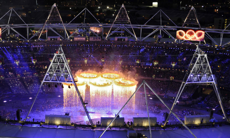 The Olympic rings are suspended over the stadium during the Opening Ceremony at the 2012 Summer Olympics, Friday, July 27, 2012, in London. (AP Photo/Mark J. Terrill)