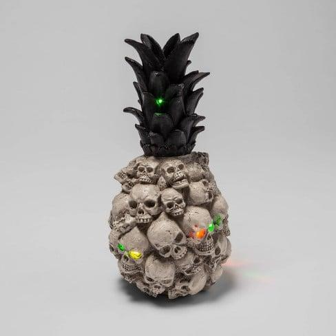 """<p>Macabre meets Malibu with this delightfully creepy <product href=""""https://www.target.com/p/light-up-skull-pineapple-halloween-decor-hyde-38-eek-boutique-8482/-/A-78639436"""" target=""""_blank"""" class=""""ga-track"""" data-ga-category=""""internal click"""" data-ga-label=""""https://www.target.com/p/light-up-skull-pineapple-halloween-decor-hyde-38-eek-boutique-8482/-/A-78639436"""" data-ga-action=""""body text link"""">Light Up Skull Pineapple Halloween Decor - Hyde &amp; EEK! Boutique</product> ($15), which features embossed skulls with light-up eyes.</p>"""