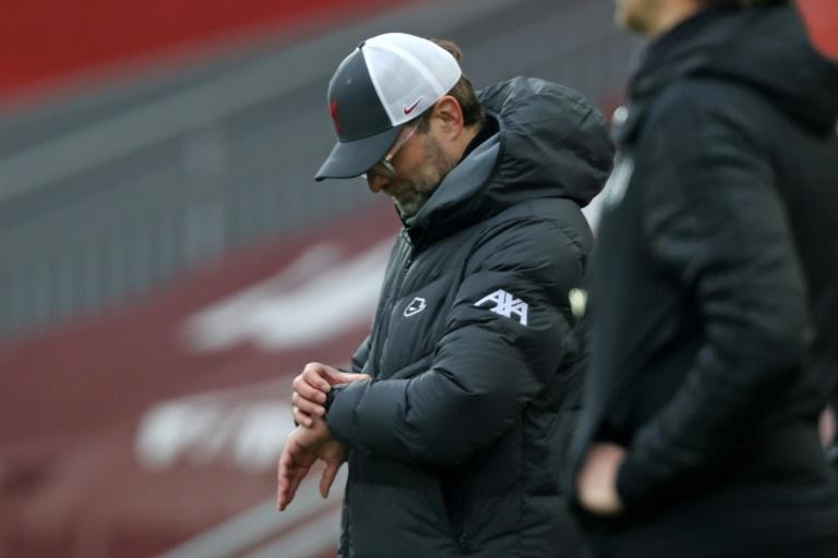 Problems for Liverpool manager Jurgen Klopp who checks his watch in the defeat against Fulham