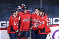 Washington Capitals right wing Anthony Mantha (39) celebrates his goal with defenseman Dmitry Orlov (9), right wing T.J. Oshie (77) and center Nicklas Backstrom (19) during the second period of an NHL hockey game against the Philadelphia Flyers, Tuesday, April 13, 2021, in Washington. (AP Photo/Nick Wass)