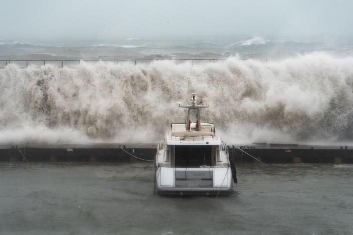 Big waves overpass a breakwater at the Port Olympic marina in Barcelona as storm Gloria batters Spain (Getty)