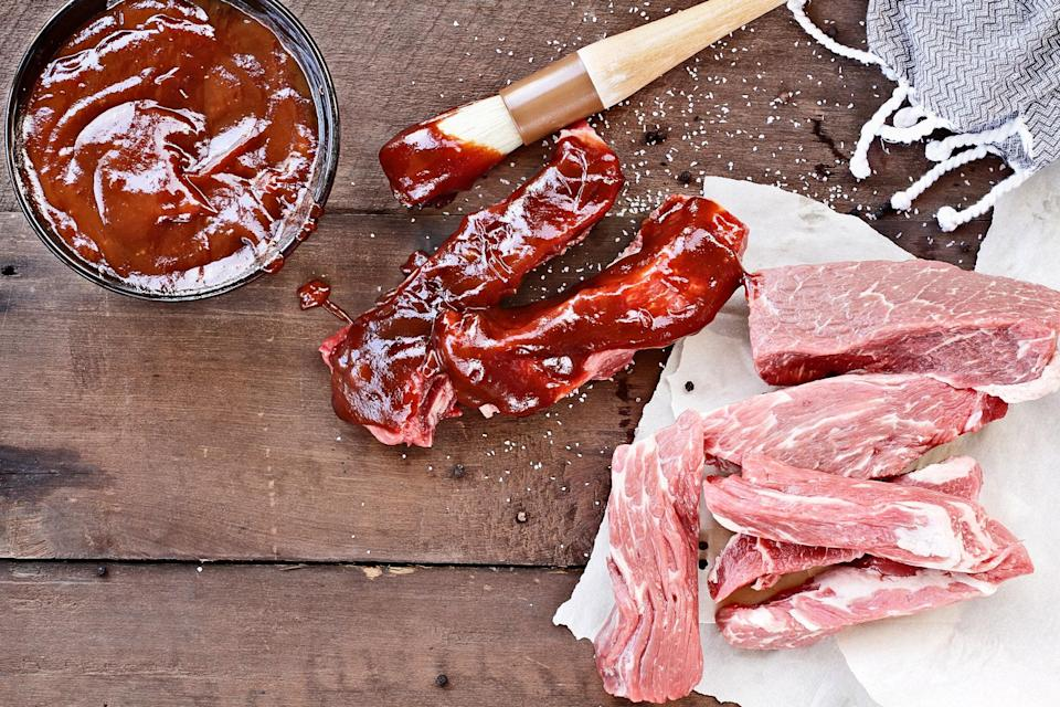 """Tender, tangy, and accented with just a hint of bourbon, these slow-cooker–cooked ribs are messy, saucy, and perfect for devouring over a long weekend. <a href=""""https://www.epicurious.com/recipes/food/views/country-style-pork-ribs-with-bourbon-and-coke-bbq-sauce?mbid=synd_yahoo_rss"""" rel=""""nofollow noopener"""" target=""""_blank"""" data-ylk=""""slk:See recipe."""" class=""""link rapid-noclick-resp"""">See recipe.</a>"""
