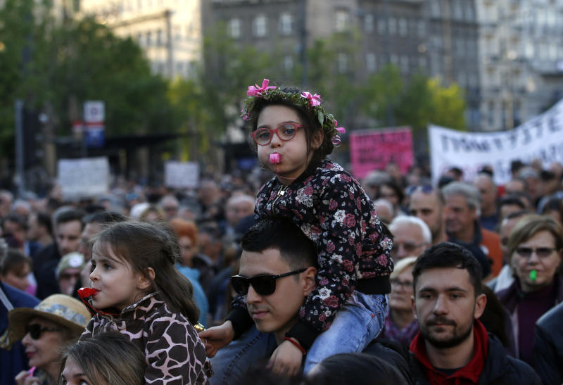 A girl blows a whistle during a protest march against President Aleksandar Vucic in Belgrade, Serbia, Saturday, April 20, 2019. Thousands of people have rallied in Serbia's capital for 20th week in a row against populist President Aleksandar Vucic and his government. (AP Photo/Darko Vojinovic)